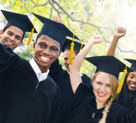 High School Students Graduating in Black Cap and Gowns with Yellow Tassles