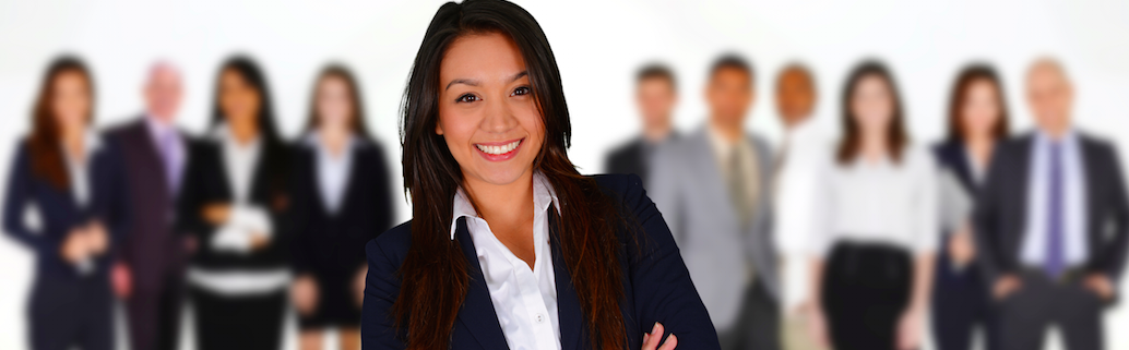 key employee selection showing a business woman standing in front of multiple blurred out other business people