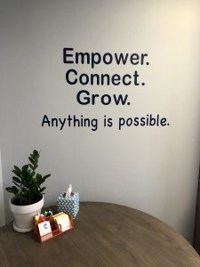 shelly stotzer brand phrase on wall of office
