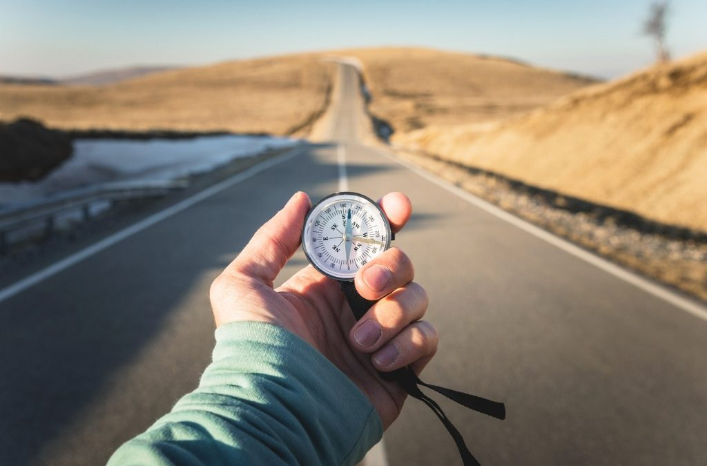 finding the right career blog image with hand holding a compass